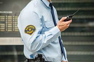 Security guard with walkie talkie