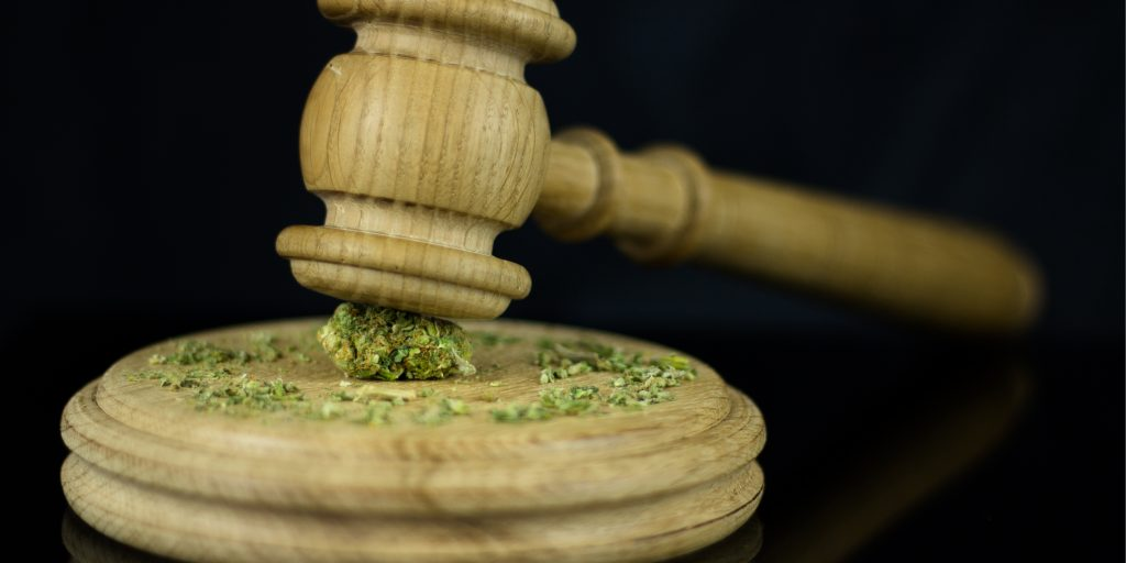Gavel on top of weed