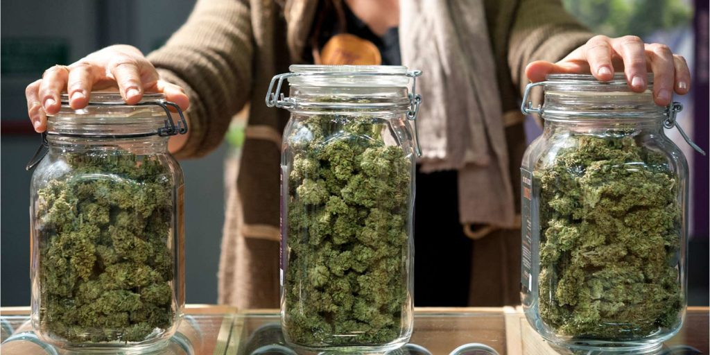 jars of different strains of weed that could make you sleepy