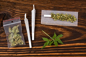rolled joints and other cannabis nuggets on a table that are fresh from a dispensary
