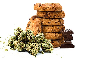 weed cookies are shown in a stack with cannabis buds around them