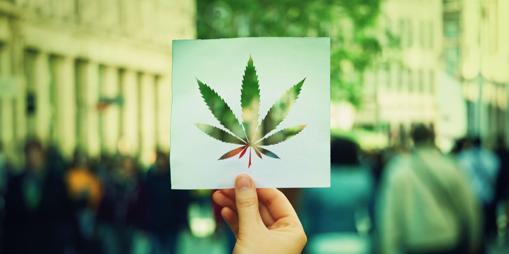 a cut out of weed shape in paper