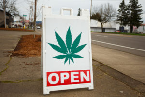 cannabis shop that sells edibles put out sign that conveys they are open