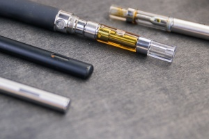 a couple different  Cannabis Cartridge being shown to choose the right type