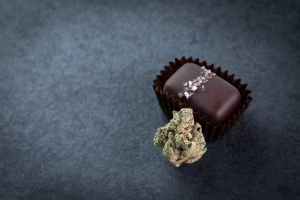 Cannabis Edibles laying on table with flower and chocolate