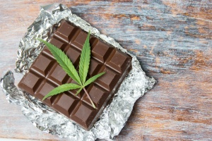 cannabis edibles of chocolate bar with leaf on it
